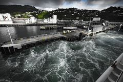 Waves at Port of Ships in New Zealand  d.y. Stormy waters at the harbor of ships in New Zealandnd.y Stock Images