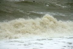 Stormy waters in the north sea. Stormy waters whipped up on the north coast of Norfolk Uk by a strong onshore wind Stock Photo