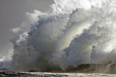 Stormy wave. Huge stormy wave over mouth of river Ave pier, Vila do Conde, north of Portugal Stock Photography