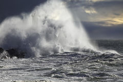 Stormy wave over beacon. Stormy big wave over river mouth beacon. Enhanced sky. Portugal Stock Photography