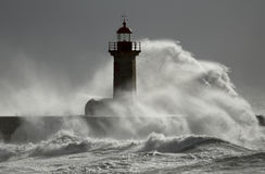 Stormy wave over lighthouse Royalty Free Stock Photography