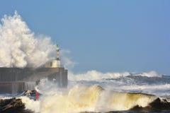Stormy wave over lighthouse of San Esteban de Pravia. Royalty Free Stock Image