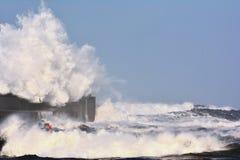 Stormy wave over lighthouse of San Esteban de Pravia. Stock Image