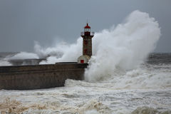 Stormy wave over lighthouses and piers Royalty Free Stock Photo