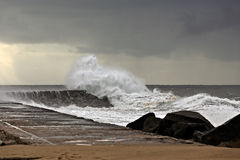 Stormy wave over pier Royalty Free Stock Photo