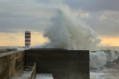 Stormy waves against pier Stock Photos