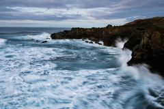 Stormy Waves, Rocky Cliffs. Stormy water of ocean waves, Atlantic, Canary Stock Images