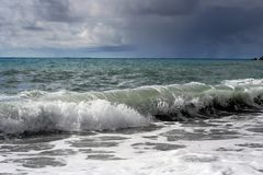 Stormy waves on the beach Royalty Free Stock Photo