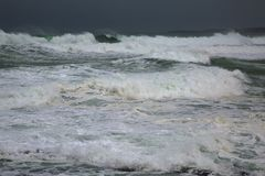 Stormy Waves Breaking. Extremely strong waves in the wind Royalty Free Stock Photos