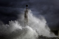Stormy waves over lighthouse Stock Photography