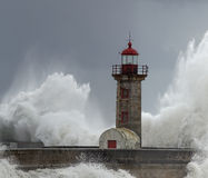 Stormy waves over lighthouse Stock Image