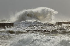 Stormy waves over pier Stock Image