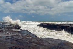 Stormy Waves Splash, Muriwai, New Zealand. Stormy Waves Splash, Muriwai Cliffs, West Coastof North Island of New Zealand royalty free stock images