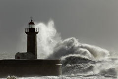 Stormy waves and spray over lighthouse Stock Image