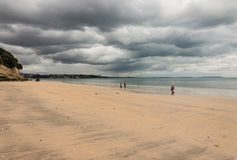 Stormy weather above sandy beach. In New Zealand royalty free stock images