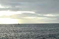 Stormy weather on a choppy sea. Stormy weather conditions and a lonely yacht on a choppy sea Stock Image