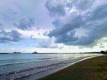 Stormy Weather. Clouds beach sea seashore beachwalk sky dramaticsky blue nature landscape seascape stock images