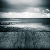 Stormy weather on the coast. View from dark wooden gangway or br Stock Images