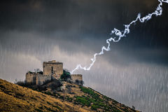 Stormy weather concept with lightning over a castle. Stock Images