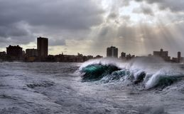 Stormy weather in Havana. Stormy weather hitting The Malecon in Havana, waves crash over the protective seawall in these dramatic weather images. Cuba Stock Photography