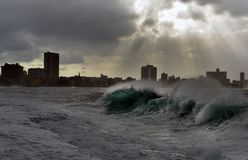 Stormy weather in Havana. Stormy weather hitting The Malecon in Havana, waves crash over the protective seawall in these dramatic weather images. Cuba Stock Image