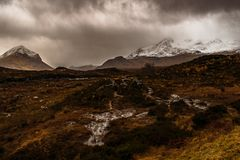 Moor on the Isle of Skye. Stormy weather on the Isle of Skye and everywhere is moor and swamps, in the background are mountains stock image