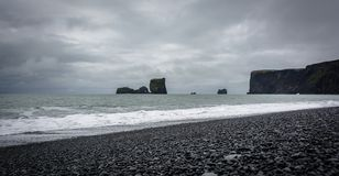 Stormy weather on the Kirkjufjara beach. South coast of Iceland, Europe. Royalty Free Stock Image