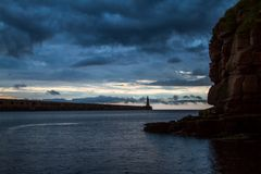 Stormy weather looms over the pier royalty free stock photos