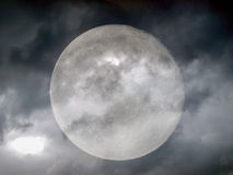 Stormy weather moon. Full moon behind clouds in stormy weather (seen through my own telescope - no NASA images used stock images