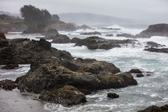 Stormy Weather and Northern California Coastline. Waves from the Pacific Ocean crash against the dramatic coastline of northern California. This scenic area just Stock Photo