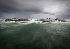 Stormy weather on the ocean with an island Stock Photo