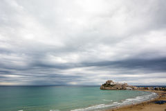 Stormy weather. Over Peñiscola's Castle and its beach Stock Image
