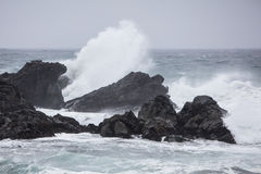 Stormy Weather and Rocky California Coastline. Waves from the Pacific Ocean crash against the dramatic coastline of northern California. This scenic area just Stock Photos