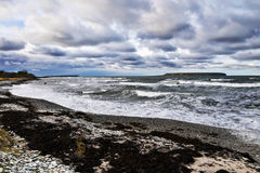 Stormy weather by the sea. With waves and clouds and islands Stock Images