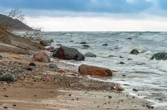 Stormy weather by the sea, rocky beach royalty free stock photos