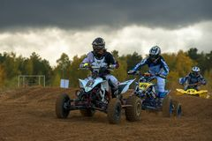 In stormy weather. SERPUKHOV, RUSSIA - OCTOBER 7, 2017: Morgunov Oleg 67,  Class ATV, in the 4 stage  MX series, the Red Wings Cup 2017 super country-cross, Moto Royalty Free Stock Images