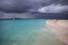 Stormy weather, storm is coming to the Maldivian beach. Stormy weather with rain on the beach. Just a few minutes before a powerful storm in Maldives stock photo