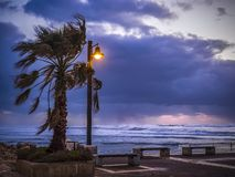 Stormy wind weather on the shores of the Mediterranean Sea, twilight, burning lantern. royalty free stock photo