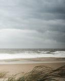 Stormy windy beach cloudy sky Stock Image