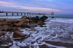Stormy winter Black Sea landscape in Burgas bay, Bulgaria. Blue hour sunset Royalty Free Stock Images