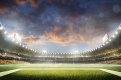 Storslagen fotbollarena för tom natt i ljus Arkivfoton