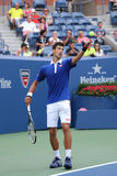 Storslagen Slam för nio gånger mästare Novak Djokovic i handling under den första runda matchen på US Open 2015 Arkivfoto