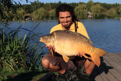 Stort fisktillfångatagande, genom att fiska Arkivfoto