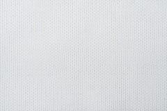 Stort handarbete för tröja- eller halsduktygtextur Stucken ärmlös tröjabakgrund med en lättnadsmodell Ullhandmaskin Arkivbilder