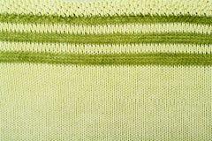 Stort handarbete för tröja- eller halsduktygtextur Stucken ärmlös tröjabakgrund med en lättnadsmodell Ullhandmaskin Royaltyfria Bilder