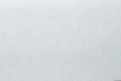 Stort handarbete för tröja- eller halsduktygtextur Stucken ärmlös tröjabakgrund med en lättnadsmodell Ullhandmaskin arkivbild