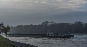 Stort lastfartyg i den Devin byn på den Dunaj floden royaltyfri bild