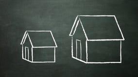Stort och litet hus Arkivfoto
