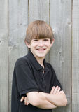 stort tonårs- pojkeleende arkivfoto