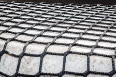 Stort tygingrepp som är stort netto på gatan Arkivfoto